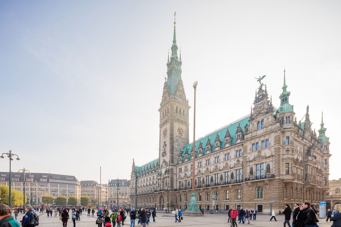 Hamburg, Germany - October 31, 2015: The famous townhall of Hamburg, Germany. Lots of people are walking in front of it on the big Rathausplatz. The townhall was erected in the 1880s. Lots of detail in the image. XXXL size image. Image taken with Canon 5Ds and TS 17mm.